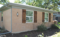 A brick home with new gutter installed