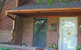 A red brick home with a new gutter installed