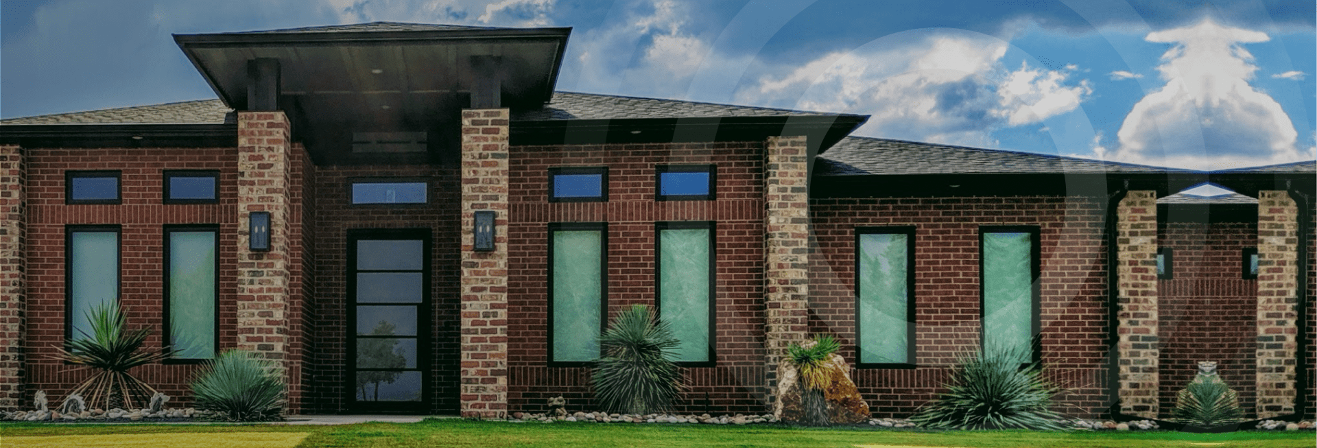 A red brick building with a new gutter system installed