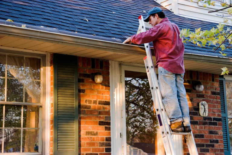 Man Cleaning Out & Maintaining Gutters